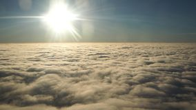 Landscape from the airplane window to a massive sea of clouds in a blue sky Royalty Free Stock Images