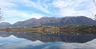 Landscape Albania lake trees awesome sky reflection mountain hills tree ablero park panorama Royalty Free Stock Image