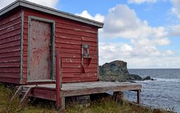 Shed on the shore of Biscayan Cove, NL Canada. Landscape along the Killick Coast, abandoned old red shed on the shore of Biscayan Cove, Avalon Peninsula, NL royalty free stock photos