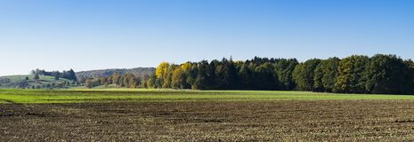 Landscape along Romantic Road, Buchdorf, Germany. panorama. Panorama photo of meadow and green hills of Buchdorf, Germany, Europe, against blue sky and space for royalty free stock photos