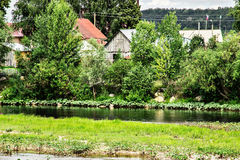 Landscape. Along the village flowing mountain river stock photo