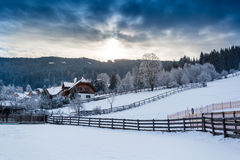 Landscape of Alpine town in mountains covered in snow Royalty Free Stock Photography