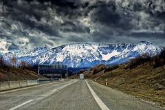 Landscape of the Alps mountains and the road to town of Fussen royalty free stock image