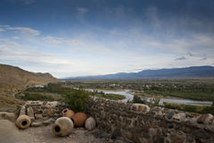 Landscape with amphoras. Mountain landscape with amphoras and diotas on a foreground and river on a background royalty free stock photo