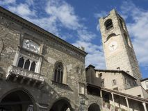 Bergamo - Old city. Landscape on the the ancient Administration Headquarter called Palazzo della Ragione and the clock tower calle. Landscape on the the ancient Royalty Free Stock Image