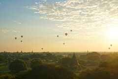 Landscape of ancient pagoda and balloon floating over the orange sky sunrise in the morning at Bagan , Mandalay , Myanmar Travel a