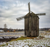 Landscape with an ancient wooden windmill in Dikanka village, Ukraine Stock Images
