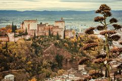 Landscape of Andalusia. Towers of Alhambra, old houses and mountains on background of Granada. View of historical town in Andalusia, Spain royalty free stock photography