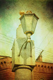 Landscape with antique street lamp. Vintage paper texture background Royalty Free Stock Photos