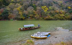 Landscape of Arashiyama in Kyoto, Japan. Kyoto, Japan - Nov 28, 2016. Tourist boats on Hozu River at Arashiyama in Kyoto, Japan. Arashiyama is a nationally Stock Photo