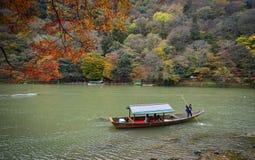 Landscape of Arashiyama in Kyoto, Japan. Kyoto, Japan - Nov 28, 2016. A tourist boat on Hozu River at Arashiyama in Kyoto, Japan. Arashiyama is a nationally Royalty Free Stock Photography