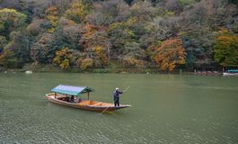 Landscape of Arashiyama in Kyoto, Japan. Kyoto, Japan - Nov 28, 2016. A wooden boat on Hozu River at Arashiyama in Kyoto, Japan. Arashiyama is a nationally Stock Photos