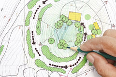 Landscape Architect Designing on plans Royalty Free Stock Images