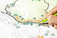 Landscape Architect Designing on site analysis plan Royalty Free Stock Images