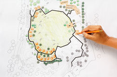 Landscape Architect Designing on site analysis plan. Royalty Free Stock Images