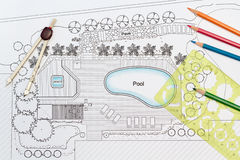 Landscape architect designs backyard plan with Pool Royalty Free Stock Image