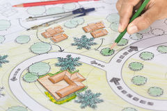 Landscape Architect Designs Blueprints For Resort. Royalty Free Stock Photography