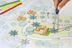 Landscape Architect Designs Blueprints For Resort. Royalty Free Stock Photo