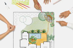 Landscape architect meeting with client. Landscape architect changing drawing at meeting with client Stock Image