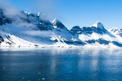 Arctic Landscape, Svalbard Island, Norway 2018. A landscape of the Arctic Island of Svalbard Norway, with Icebergs, Mountains and Ice stock photography