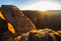 Landscape around the Mesa Arch at sunrise Stock Photos