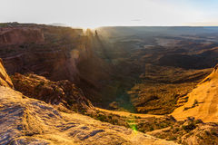 Landscape around the Mesa Arch at sunrise Stock Photo