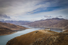 Landscape around Yamdrok Lake, Tibet. Yamdrok Lake (also named Yamdrok Yumtso or Yamzho Yumco) in Tibet. Photo taken in December 2014 Royalty Free Stock Photography