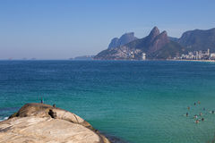 Landscape of Arpoador Beach, Brazil. Landscape of Arpoador beach, with a view to Ipanema, Leblon and surfers, Brazil Royalty Free Stock Images