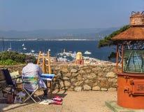 Landscape artist. Artist painting a landscape on St. Tropez, France Stock Images