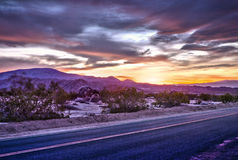 Landscape with asphalt road in the desert at dusk Stock Images
