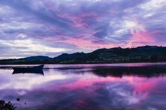 Landscape from Asturias, Spain.Reflection of Single Boat. With dramatic Sky During Sunrise Sunset royalty free stock photography