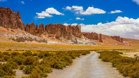 Landscape in Atacama desert. With a pathway and mountains on the background stock photos