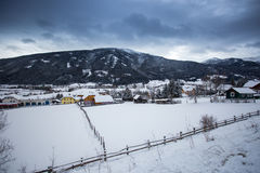Landscape of Austrian town in valley at Alps covered by snow Royalty Free Stock Photos