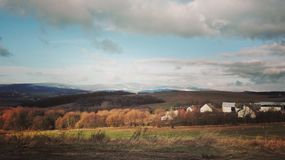 Landscape in autumn. Clouds and sky in  the valley Stock Images