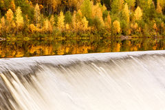 Landscape with autumn forest, dam on the river and reflection. Finland Stock Photography