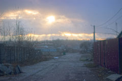 Landscape in autumn park sun rays first snow Royalty Free Stock Photos