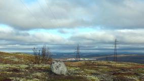 Landscape with autumn tundra, stone and Northern birch and low   rushing clouds. stock footage