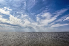 Landscape of the Azov sea. The landscape of the Azov sea with clouds on blue sky Stock Image