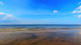 Landscape background with light clouds over Baltic sea near shoreline, selective focus.  royalty free stock photography