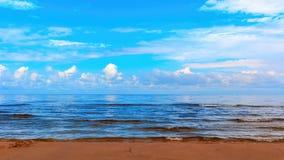 Landscape background with light clouds over Baltic sea near shoreline, selective focus.  stock photos