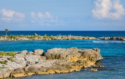 Landscape with balanced rocks, stones on a rocky coral pier. Turquiose blue Caribbean sea water. Riviera Maya, Cancun, Mexico. Landscape with balanced rocks stock photography