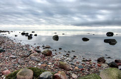 Landscape of the Baltic Sea. A landscape image of the Baltic Sea with rocks and stones under a blue sky stock photography