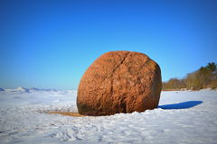 Landscape of Baltic seaside in a winter day. Landscape of Baltic seaside in a winter sunny day, big stone Stock Photo