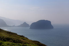 Landscape of the Basque coast near the lighthouse at Cape Matxic. Haco,Machichaco, Biscay, Basque Country, Spain royalty free stock photo