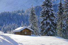 Landscape in Bavaria with alpine hut at winter stock photography