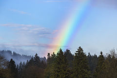 Landscape of Bavarian mountains with rainbow Stock Image