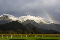 Landscape of Bavarian mountains with rainbow Royalty Free Stock Photo