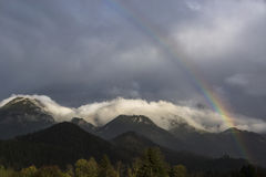 Landscape of Bavarian mountains with rainbow Stock Photos