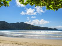 Landscape of beach with hills in the background. Beach landscape in sunny day, with forest hills in the background Stock Photo