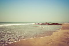 Landscape, beach in the Indian ocean, waves and rocks. Indian ocean stock images